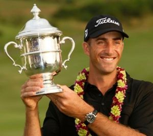 Geoff Ogilvy sports the winner's trophy and a new sposnor in Hawaii