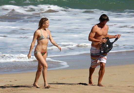 Some might only see actress Kate Hudson pictured here with Adam Scott in Maui. We just note Scott learned his lesson after a beach incident put him out of action in Australia and he is now wearing a knee brace in the surf.