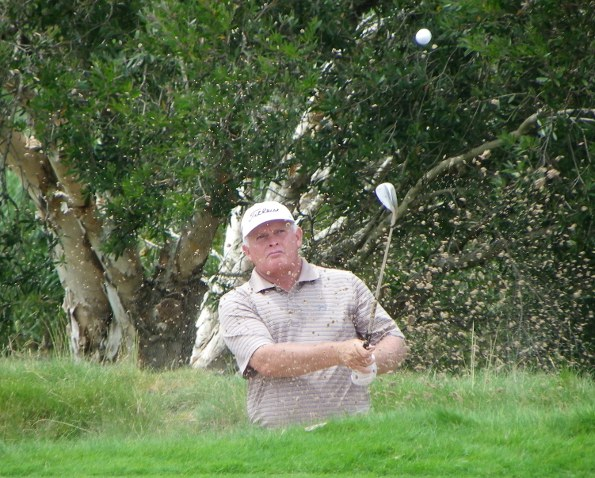 Peter Senior splashes out of a bunker at the 2010 Australian Open. Photo: Brian O'Hare