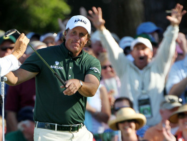 Fans celebrate as Mickelson takes his putter to add a birdie on the 15th to his back to back eagles