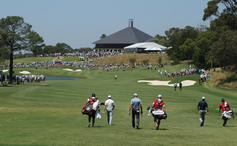 Jordan Spieth, Geoff Ogilvy and Lee Westwood walking down the 9th to a sizable Thursday crowd