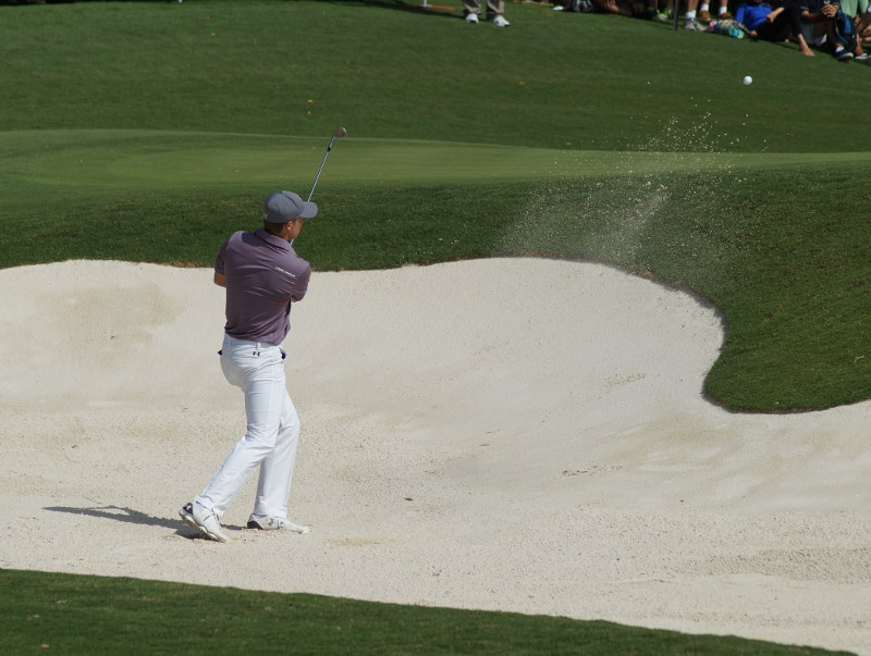 Jordan Spieth splashes one close from a bunker late in his second round