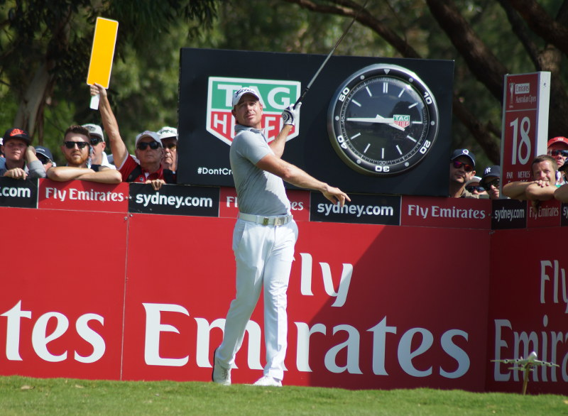 Adam Scott's final round playing partner Brett Rumford was trying out a new swing action on the 18th