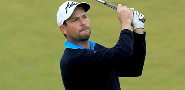 "ENGLAND'S David Howell celebrated reaching the end of a ""long, long road from the depths of despair"" after claiming his first European Tour title in seven years."