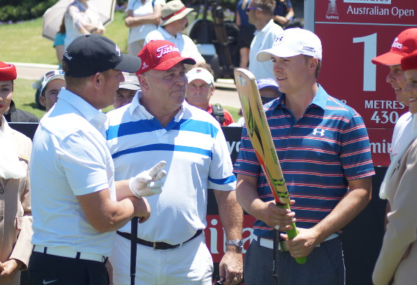 Spieth seems to like it in Australia ... even when unusual people like Shane Warne present him with strange wooden clubs