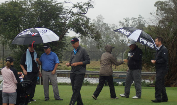 Peter Senior, Mike Harwood (centre) and Rodger Davis prepare for a soggy first playoff hole