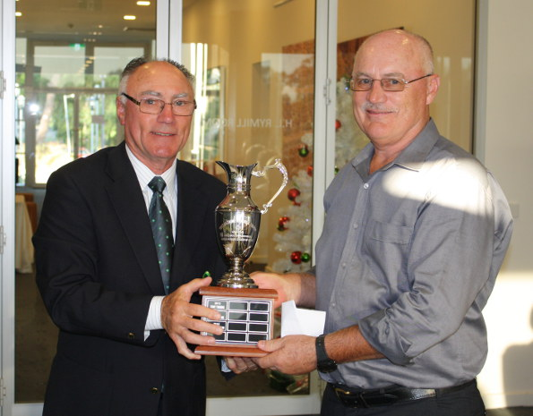 2015 SA Senior Order of Merit Over 65 winner Chris Claxton receives the Tony Mazzone Trophy