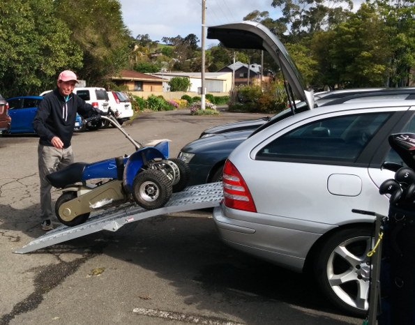 With just a couple of ramps Tony McRae from Jamberoo Golf Club has no trouble getting his Cruiser into the back of what is only a small/medium size station wagon.