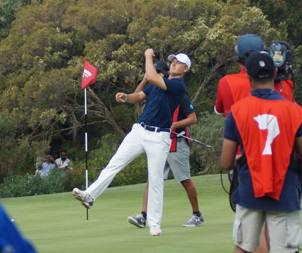 An elated Jordan Spieth tosses his ball to the crowd after winning a sudden death playoff to take the 2016 Australian Open