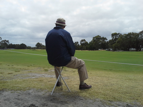 Whilst many golf fans at Kingston Heath find the throng of crowds, this man finds solitude