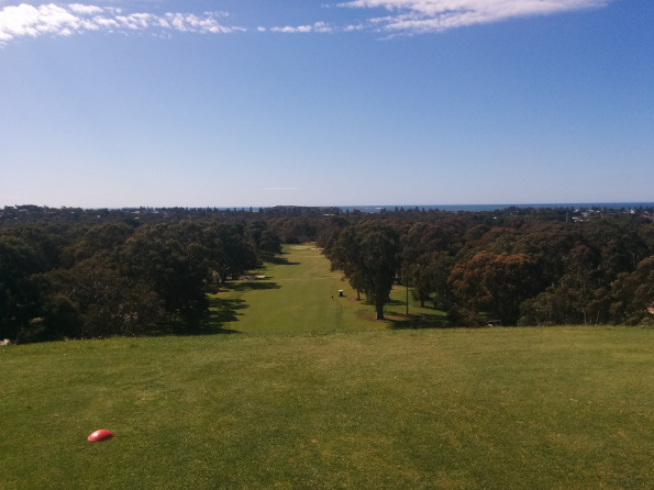 "This camera phone shot of the first hole at Victor Harbour doesn't really do the Australia's Iconic Golf Holes ""Hall of Famer"" justice. You get an idea of the scale if you look at the little golf cart halfway down the fairway on the right"