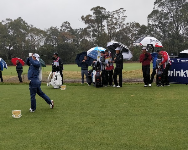 World Cup of Golf Day 2: Surprise leaders as weather lashes players, course … and hardy fans