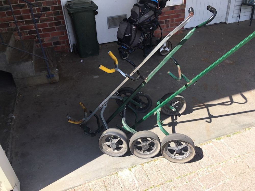 Old steel golf push buggy